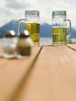 Germany, Bavaria,Tegernsee, Beer glasses on table - KMF00680