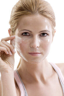 Woman removing face mask - MAEF00241