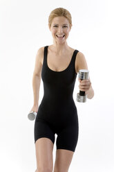 Woman exercising with dumbbells - MAEF00226