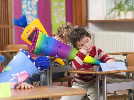Children (4-7) in classroom, holding school cones - WESTF04572
