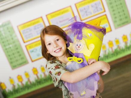 Girl holding schoolcone - WESTF04456