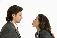Businessman and businesswoman discussing, side view - WESTF04698