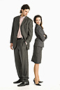 Two businesspeople standing back to back - WESTF04695