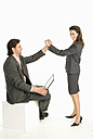 Business colleagues giving high five, smiling, side view - WESTF04668