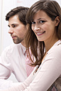 Businessman and woman in office, close-up - WESTF04662