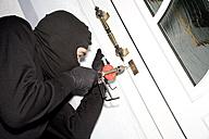 Burglar breaking lock, close-up - MAE00304