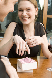 Woman rejoicing over jewellery - NHF00520