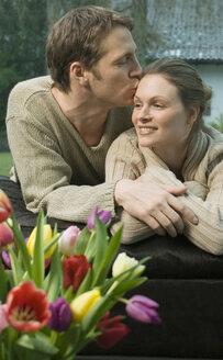Man kissing woman's forehead - NHF00484