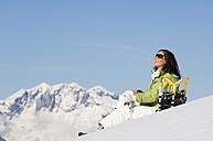 Woman with snowshoes, relaxing - HHF01368