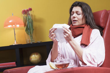 Woman having cold, hoding handkerchief - HHF01330