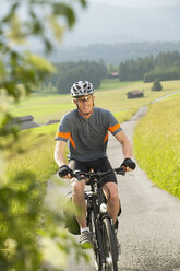 Cyclist on a country lane - MRF00891