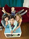 Girls lying on sofa an coffee table - KMF00946