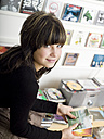 Young girl (16-17), portrait, holding cd´s - KMF00928