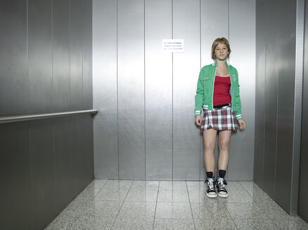 Young woman standing in lift - KMF00895
