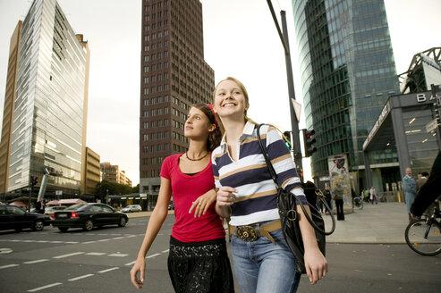 Two girl friends strolling in city - KMF00856