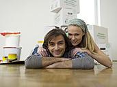 Couple lying on floor, looking to cmera - WESTF05162