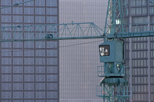Germany, Frankfurt, crane against high rise buildings - TLF00024