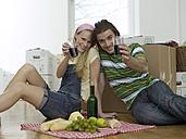 Couple having break in new flat - WESTF05238