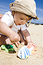 Baby (6-9 months) playing on the beach, portrait - LDF00500