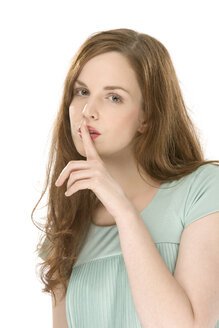 Young woman, finger on lips, portrait - CLF00396