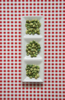 Wasabi peas in bowl, elevated view - TL00114