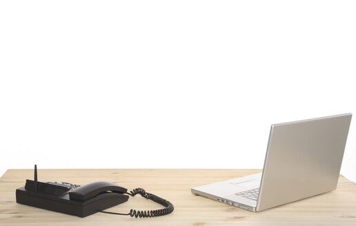 Laptop and telephone on desk, close-up - PKF00185
