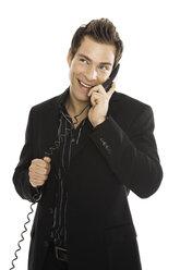 Young man using phone, close-up - PKF00161