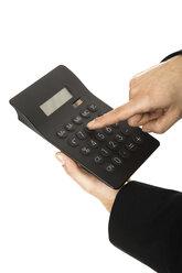 Man using calculator, close-up - PKF00158