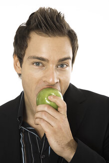 Young man holding green apple, close-up - PKF00152