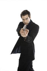Young man holding hand gun, close-up - PKF00149