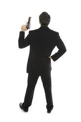 Young man holding hand gun, close-up - PKF00146