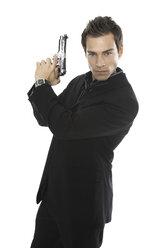 Young man holding hand gun, close-up - PKF00143