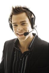 Young man wearing head set, close-up - PKF00137