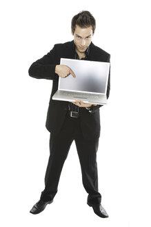 Young man holding laptop, close-up - PKF00128