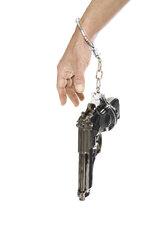 Pistol hanging on arm, close-up - PKF00101