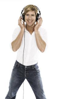 Man wearing head phones, close-up - PKF00092