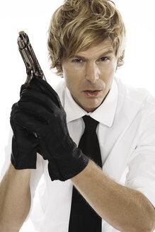 Man holding gun, close-up - PKF00086