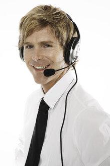 Man wearing head set, close-up - PKF00083