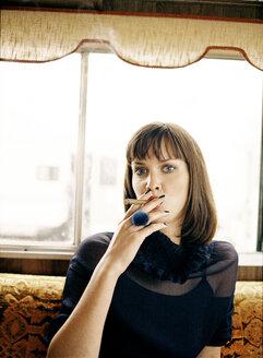 Woman smoking cigar, portrait - PK00224