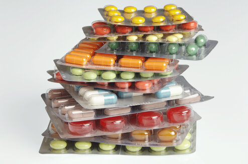 Several tablets and capsules in blister packs, close-up - CR01281