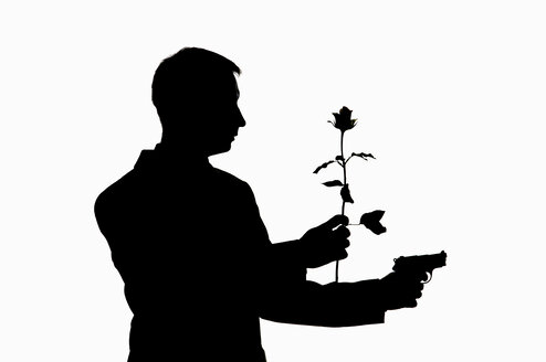 Man holding gun and rose, silhouette - CRF01312
