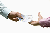 Businesspeople exchanging money, close-up - CLF00467