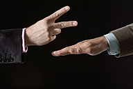Businessmen playing rock paper scissors, close-up of hands - CLF00464
