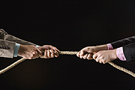 Businessmen pulling rope, close-up - CLF00461