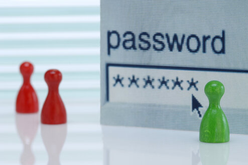 Game pieces, Password field in background, close- up - AS03439