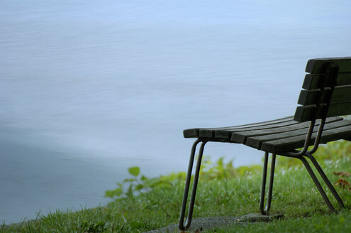 Germany, Lake Constance, bench at water side - SMF00203