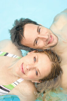 Germany, couple relaxing in swimming pool, portrait, close-up - BABF00337