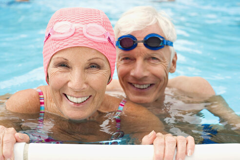 Germany, Senior couple in swimming pool - BABF00271