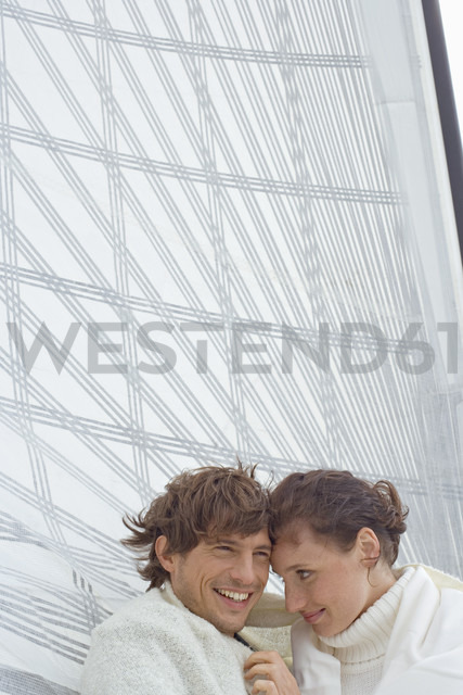 Germany, Baltic Sea, Lübecker Bucht, Young couple on sailing boat, portrait - BAB00441