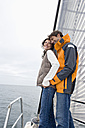Germany, Baltic Sea, Lübecker Bucht, Young couple on sailing boat - BAB00399